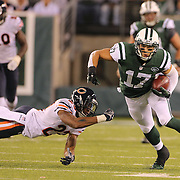 Greg Salas, New York Jets, avoided the tackle of Kyle Fuller, Chicago Bears, during the New York Jets Vs Chicago Bears, NFL regular season game at MetLife Stadium, East Rutherford, NJ, USA. 22nd September 2014. Photo Tim Clayton for the New York Times