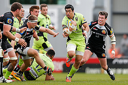 Northampton Outside Centre George Pisi is challenged by Exeter Chiefs Scrum-Half Will Chudley - Photo mandatory by-line: Rogan Thomson/JMP - 07966 386802 - 11/04/2015 - SPORT - RUGBY UNION - Exeter, England - Sandy Park Stadium - Exeter Chiefs v Northampton Saints - Aviva Premiership.