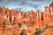 Landscape views of Bryce Canyon National Park. The unique red sandstone columns are called hoodoos and are unique to the park.  They are carved by the relentless freezing and thawing of water trapped in the crevices of the stone.  A closer view of the hoodoos from Inspiration Point.