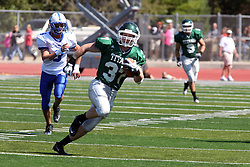 17 September 2011: Mike Heaton heads up field with the ball during an NCAA Division 3 football game between the Aurora Spartans and the Illinois Wesleyan Titans on Wilder Field inside Tucci Stadium in.Bloomington Illinois.