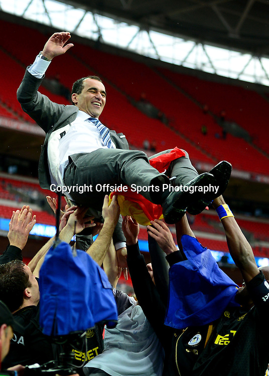 11th May 2013 - The FA Cup Final  - Manchester City v Wigan Athletic - Roberto Martinez, Manager of Wigan Athletic is thrown into the air by his players as they celebrate - Photo: Marc Atkins / Offside.