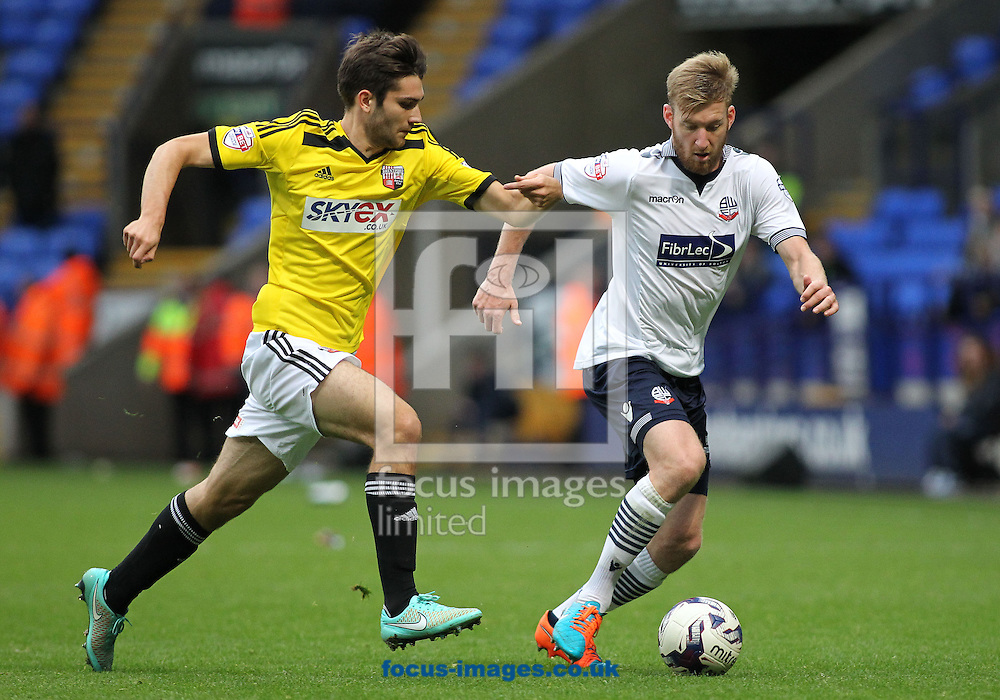 Jon Toral of Brentford and Tim Ream of Bolton Wanderers in action during the Sky Bet Championship match at the Macron Stadium, Bolton.<br /> Picture by Michael Sedgwick/Focus Images Ltd +44 7900 363072<br /> 25/10/2014