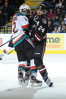 KELOWNA, CANADA - FEBRUARY 18: Matt Dumba #24 of the Red Deer Rebels collides with Tyrell Goulbourne #12 of the Kelowna Rockets on the ice as the Red Deer Rebels visit the Kelowna Rockets on February 18, 2012 at Prospera Place in Kelowna, British Columbia, Canada (Photo by Marissa Baecker/Shoot the Breeze) *** Local Caption ***