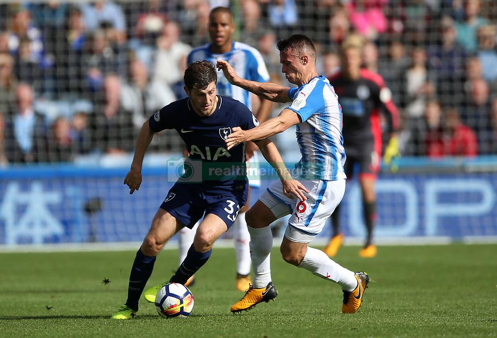 Tottenham Hotspur's Ben Davies and Huddersfield Town's Jonathan Hogg battle for the ballduring the Premier League match at the John Smith's Stadium, Huddersfield.