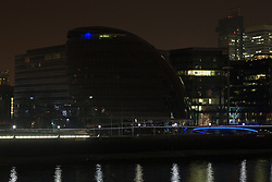 © Licensed to London News Pictures. 29/03/2014. London, UK. City Hall turns the lights off in support of global Earth Hour 2014 at 8:30pm local time in London on 29th March 2014. Photo credit : Vickie Flores/LNP