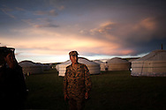CLIENT: PROJECT HOPE<br /> <br /> A member of the Mongolian Armed Forces settles in for the night at the camp for operation Pacific Angel Mongolia, a set of ger-- traditional wool-lined tents-- about five hours outside of the capitol of Ulaanbaatar, Mongolia.