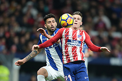 MADRID, Dec. 17, 2017  Atletico Madrid's Kevin Gameiro (R) vies with Alaves' Guillermo Maripan during the Spanish league match between Atletico Madrid and Alaves in Madrid, Spain. Atletico Madrid won 1-0. (Credit Image: © Juan Carlos Rojas/Xinhua via ZUMA Wire)