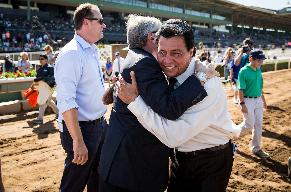 September 26 2015: Owner Paul Reddam hugs assistant trainer Leandro Mora, who suffered a stroke earlier in the week, at Santa Anita Park, Arcadia CA. Alex Evers/ESW/CSM