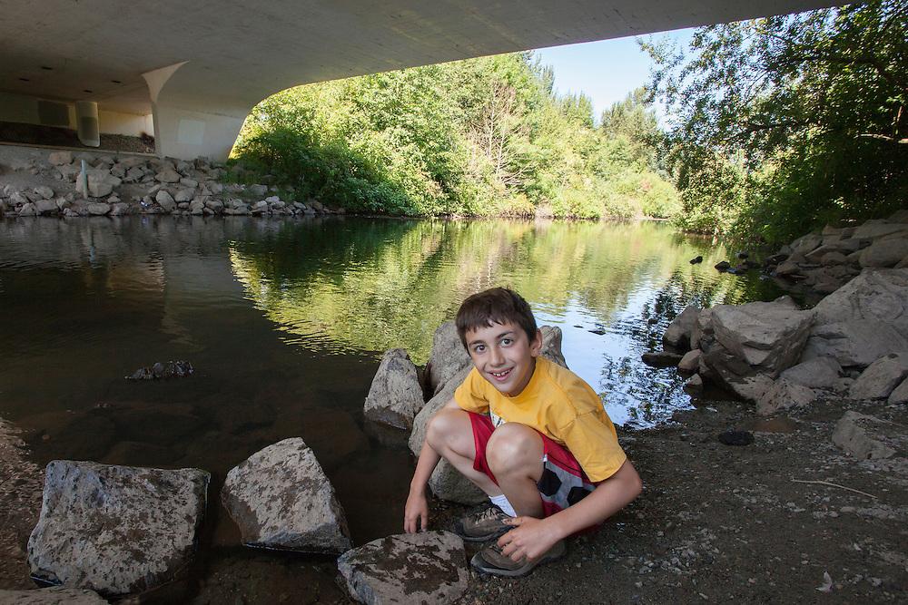 United States, Washington, Redmond, boy  under bridge on Sammamish River Trail  MR