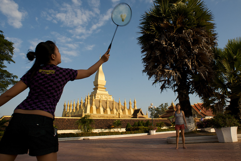 Women playing badmitton in front of Wat Si Saket, the most important spiritual site in Laos, located in Vientiane.