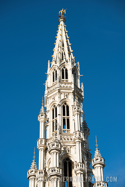 Towering 96 metres (315 feet) above the cobblestones on Grand Place, the spire of the ornate Brussels Town Hall (Hotel de Ville) is capped by a statue of Saint Michael slaying a dragon, an historic symbol for the city. Grand Place (La Grand-Place) is a UNESCO World Heritage Site in central Brussels, Belgium. Lined with ornate, historic buildings, the cobblestone square is the primary tourist attraction in Brussels.