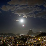 The moon rises above the City or Rio de Janeiro and the summit of Sugar Loaf Mountain, one of the iconic locations with breathtaking views of Rio de Janeiro, Brazil. 25th July 2010. Photo Tim Clayton..