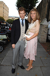 Chef TOM AIKENS and his wife AMBER at the wedding of Chloe Delevingne to Louis Buckworth at St.Paul's Knightsbridge, London on 7th September 2007.<br />