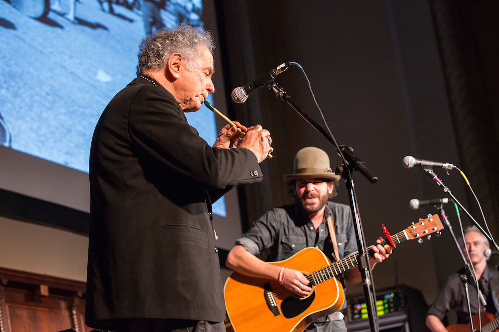 David Amram playing the pennywhistle. Langhorne Slim and John Wesley Harding are to his right.