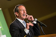 Former South Carolina Gov. Mark Sanford the Republican candidate for the open Congressional seat gestures that he can't hear a question about his extra marital affair during a debate against his democratic opponent Elizabeth Colbert Busch at the Citadel on April 29, 2013 in Charleston, South Carolina.