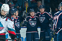 KELOWNA, BC - FEBRUARY 12: Edge Lambert #24 congratulates Connor Bouchard #19 of the Tri-City Americans on a first period goal against the Kelowna Rockets at Prospera Place on February 8, 2020 in Kelowna, Canada. (Photo by Marissa Baecker/Shoot the Breeze)