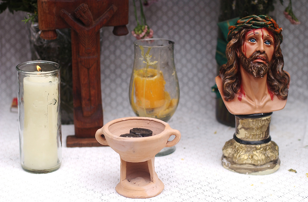 A small altar with candles, incense and a bust of Jesus during Good Friday.