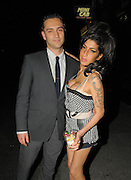 24.AUGUST.2010. LONDON<br /> <br /> AMY WINEHOUSE SPENDS THE NIGHT AT THE HAWLEY ARMS PUB IN CAMDEN. SHE WAS JOINED BY BOYFRIEND REG TRAVISS AND THE LIBERTINES FRONT MAN CARL BARAT. AMY AND REG WHERE THE LAST ONES TO LEAVE AT 3AM LOOKING VERY HAPPY AND EVEN POSED FOR PICTURES.<br /> <br /> BYLINE: EDBIMAGEARCHIVE.COM<br /> <br /> *THIS IMAGE IS STRICTLY FOR UK NEWSPAPERS AND MAGAZINES ONLY*<br /> *FOR WORLD WIDE SALES AND WEB USE PLEASE CONTACT EDBIMAGEARCHIVE - 0208 954 5968*