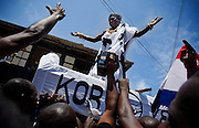 King Nana Kodwo Conduah VI, from the nearby town of Elmina, salutes followers as he is held up above the crowd during the parade held on the occasion of the annual Oguaa Fetu Afahye Festival in Cape Coast, Ghana on Saturday September 6, 2008.