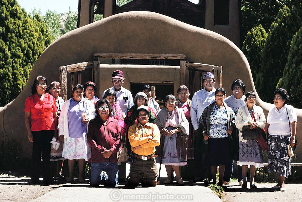 Visitors from Zia Pueblo, San Isidro in front of Chimayo Sanctuary on the road to Taos, near Santa Fe, New Mexico, USA. It is dedicated to the Madonna where supposedly a miracle occurred.