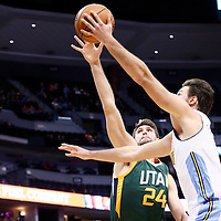 20 November 2016: Denver Nuggets forward Danilo Gallinari (8) goes for the layup past Utah Jazz center Jeff Withey (24) during the Denver Nuggets 105-91 victory over the Utah Jazz, at the Pepsi Center, Denver, Colorado, USA.