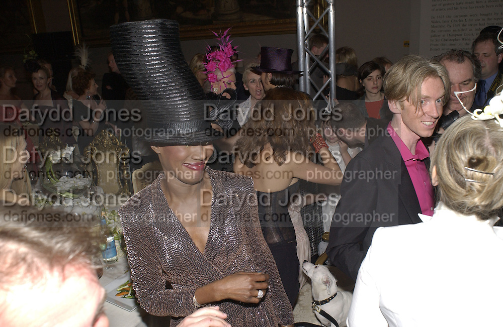 Grace Jones and Philip Treacy. Moet and Chandon fashion tribute to Philip treacy. V. & a. 16 April 2002. © Copyright Photograph by Dafydd Jones 66 Stockwell Park Rd. London SW9 0DA Tel 020 7733 0108 www.dafjones.com