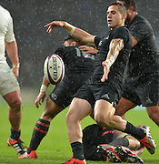 Twickenham, Great Britain,NZ's TJ PERENARA, kicking clear during the second half of the QBE Autumn International, England vs New Zealand, RFU Stadium Twickenham, Surrey.  Saturday 08/11/2014 [Mandatory Credit; Peter SPURRIER/Intersport Images]