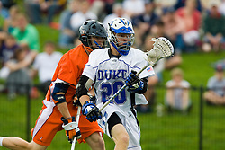 Duke midfielder Steve Schoeffel (20) in action against UVA.  The #2 ranked Duke Blue Devils defeated the #3 ranked Virginia Cavaliers 11-9 in the finals of the Men's 2008 Atlantic Coast Conference tournament at the University of Virginia's Klockner Stadium in Charlottesville, VA on April 27, 2008.