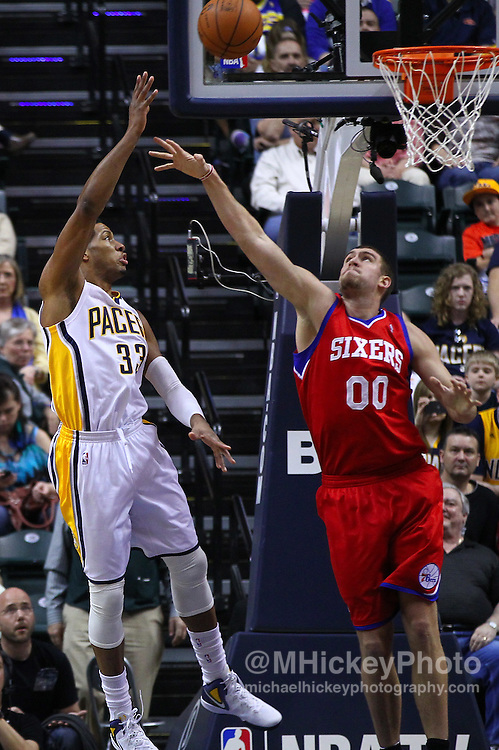 March 14, 2012; Indianapolis, IN, USA; Indiana Pacers small forward Danny Granger (33) shoots the ball against Philadelphia 76ers center Spencer Hawes (0) at Bankers Life Fieldhouse. Indiana defeated Philadelphia 111-94. Mandatory credit: Michael Hickey-US PRESSWIRE