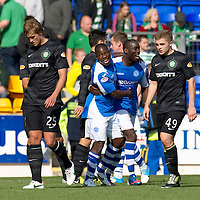 St Johnstone v Celtic....15.09.12      SPL  <br /> Nigel Hasselbaink celebrates with Gregory Tade as Thomas Rogne and James Forrest trudge off<br /> Picture by Graeme Hart.<br /> Copyright Perthshire Picture Agency<br /> Tel: 01738 623350  Mobile: 07990 594431