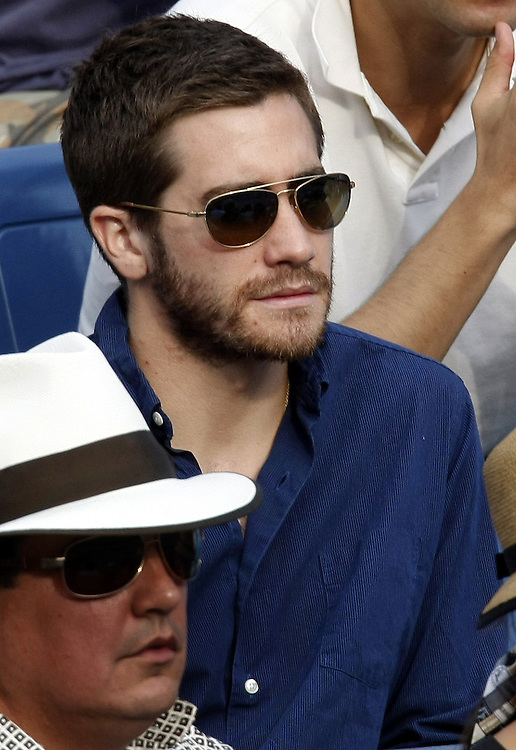 US actor Jake Gyllenhaal watches Roger Federer of Switzerland play Novak Djokovic of Serbia during the men's final on the last day of the 2007 US Open tennis tournament in Flushing Meadows, New York, USA, 09 September 2007.