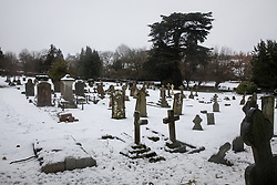 © Licensed to London News Pictures. 11/12/2017. Amersham, UK. A general view of the church yard in the snow in Amersham. Yesterday parts of the south east of England experienced heavy snow, with the home counties experiencing some of the worst conditions. Photo credit : Tom Nicholson/LNP