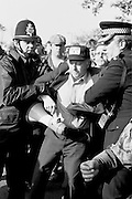 Superintendent John Nesbit arrests Arthur Scargill, NUM President at Orgreave during the 1984-85 miners strike. © Martin Jenkinson