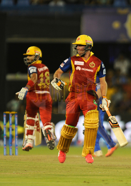 AB De Villiers of Royal Challengers Bangalore and Virat Kohli captain of Royal Challengers Bangalore run between the wickets during match 22 of the Pepsi IPL 2015 (Indian Premier League) between The Rajasthan Royals and The Royal Challengers Bangalore held at the Sardar Patel Stadium in Ahmedabad , India on the 24th April 2015.<br /> <br /> Photo by:  Pal Pillai / SPORTZPICS / IPL