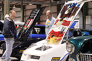 Norman Cromes of Piqua (left) and John Hurley of Sidney look over Bull Webster of Bellbrook's 1980 custom POW Chevrolet Corvette during the KOI Hot Rod Fest Dayton at the Dayton Airport Expo Center in Vandalia, Sunday, March 12, 2012.