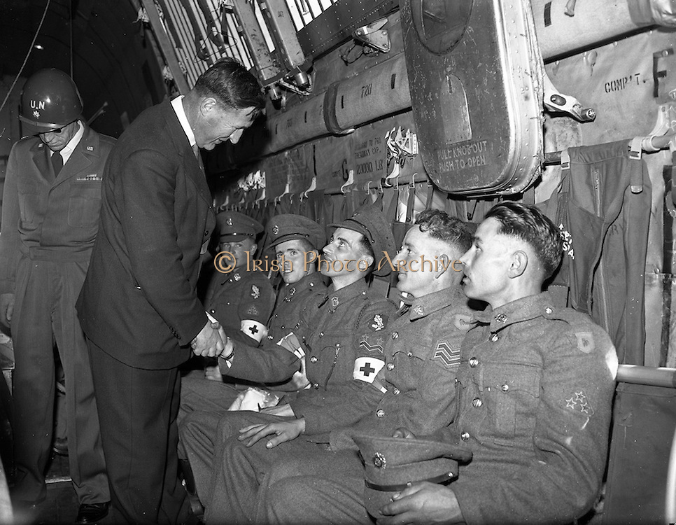 17/08/1960<br /> 08/17/1960<br /> 17 August 1960<br /> Airlift of the 33rd Battalion to the Congo. Picture shows Minister for defence Kevin Boland bidding farewell to (l-r) Private John White, Newbridge, Co. Kildare; Corporal James Durney, (shaking hands) Newbridge, Co. Kildare; Sergeant M.J. Mulcahy, Cobh, Co. Cork and Private Michael Fitzgerald on board one of the Douglas C-124 Globemaster II transport aircraft, United Nations,