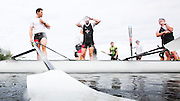 The Canadian mens four that will represent Canada at the Rio Olympic games (left to right) Kai Langerfeld, Tim Schrijver, Conlin McCabe and Will Crothers put their blades into the water prior to a morning training session on Elk Lake in Victoria, British Columbia on June 22, 2016.