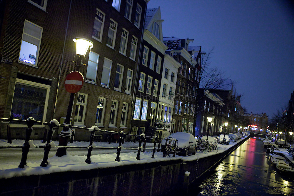 Ice forming on the Passeerdersgracht, off the Prinsengracht, at night, in the snow. Amsterdam, December 2010