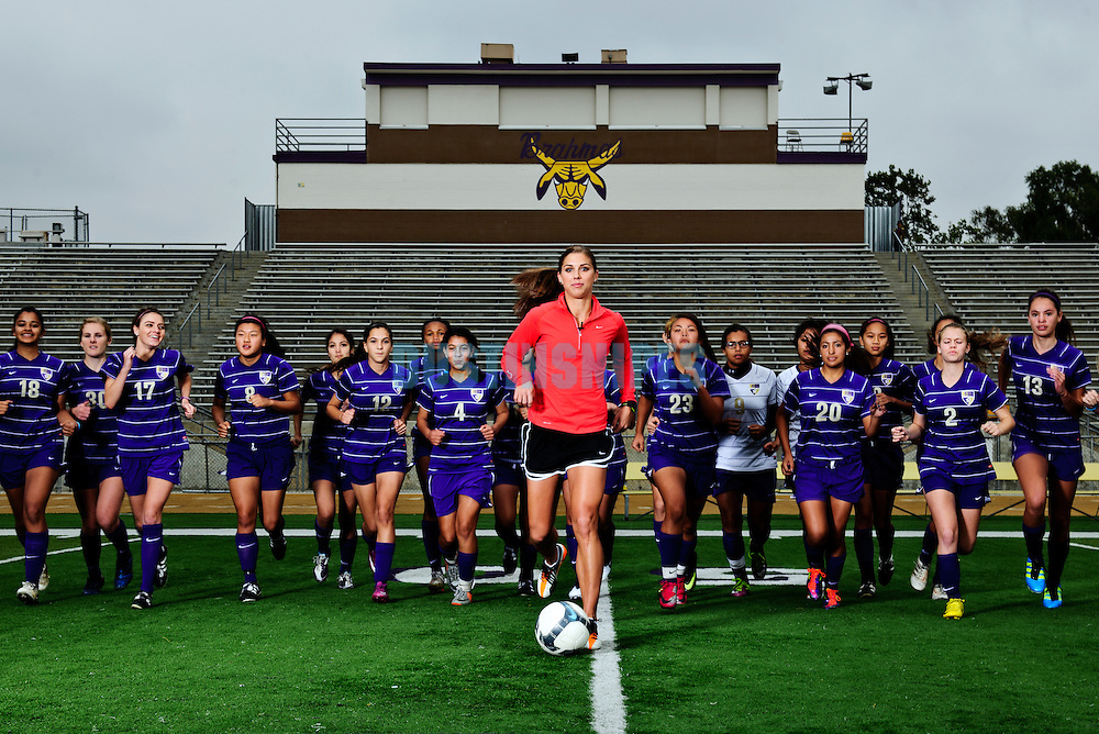 USA Soccer player Alex morgan poses for a portrait with her old high school