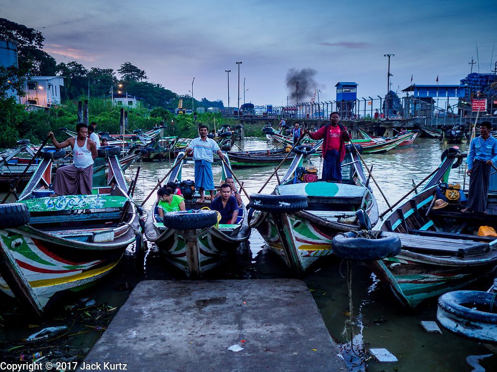 23 NOVEMBER 2017 - YANGON, MYANMAR: River taxis at the San Pya Fish Market jetty. San Pya Fish Market is one of the largest fish markets in Yangon. It's a 24 hour market, but busiest early in the morning. Most of the fish in the market is wild caught but aquaculture is expanding in Myanmar and more farmed fresh water fish is being sold now than in the past.    PHOTO BY JACK KURTZ