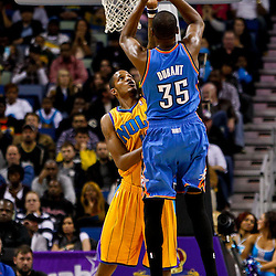 December 10, 2010; New Orleans, LA, USA; Oklahoma City Thunder forward Kevin Durant (35) shoots over New Orleans Hornets small forward Trevor Ariza (1) during the second half at the New Orleans Arena.  The Thunder defeated the Hornets 97-92. Mandatory Credit: Derick E. Hingle-US PRESSWIRE