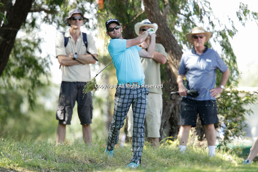 18.10.2013 Perth, Australia. Josh Geary (NZL) plays out of the rough on the 13th fairway during day 2 of the ISPS Handa Perth International Golf Championship from the Lake Karrinyup Country Club.