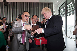 © Licensed to London News Pictures.29/05/2013.LONDON UK.. ABP (Asian Business Port) chairman Mr Xu Weiping  and  Mayor of London Boris Johnson exchange gifts, at the contract signing of Chinese business park on the 35-acre site at London's Royal Docks have been revealed..Photo credit : ANDREW BAKER/LNP