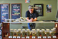 Garrett Patrick, owner of STASH, stands behind the counter at his retail marijuana store in the Aspen Airport Business Center in Aspen, Colorado.