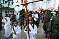 Young children carry wooden crosses in a religious parade in Quibdo, the capital of the state of Choco, on October 4, 2006. Choco is a state that has suffered terribly at the hands of both rightwing paramilitaries and leftist rebels over the years, causing many to flee to other parts of Colombia. The Choco is located on the Pacific coast of Colombia and most of the people are black descendants of African slaves. (Photo/Scott Dalton)