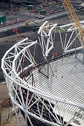Client: Olympic Delivery Authority. Image of the Olympic Stadium with the final compression truss being moved into place. Photo: Anthony Charlton