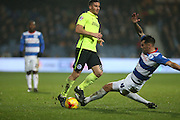 Queens Park Rangers defender Grant Hall (4) tackles Brighton striker, Tomer Hemed (10) during the Sky Bet Championship match between Queens Park Rangers and Brighton and Hove Albion at the Loftus Road Stadium, London, England on 15 December 2015.
