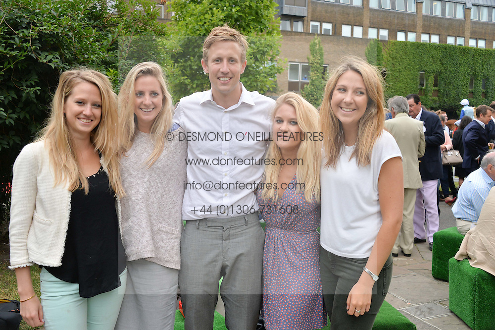 Left to right, SUSIE PEACHEY, HOLLY STIRK, GEORGE FROST, CAROLINE SLACK and AISLING CRAPNELL at the launch of Chelsea Thoroughbreds held at St.Luke's Church, Sydney Street, London on 2nd July 2014.