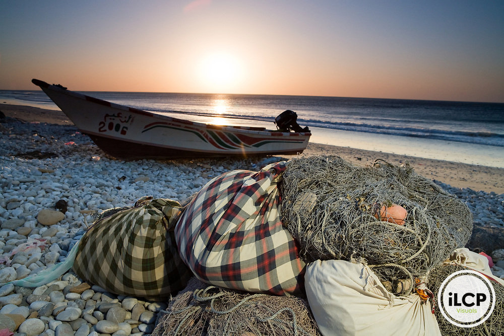 Fishing boat and nets on beach at sunrise, Hawf Protected Area, Yemen