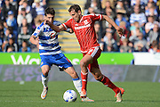 Reading striker Lucaso Piazon challenges Middlesbrough striker Christian Stuani during the Sky Bet Championship match between Reading and Middlesbrough at the Madejski Stadium, Reading, England on 3 October 2015. Photo by Alan Franklin.